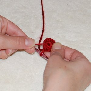 Keep pulling tail until you close up the crochet center. And there's the magic of the magic ring crochet technique!