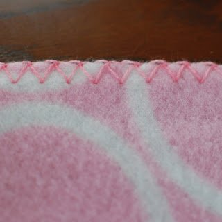 Crochet Edging on Fleece Blanket - Step 2 | www.petalstopicots.com
