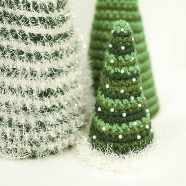 Crochet up three sizes of Christmas Tree Patterns for a beautiful centerpiece.