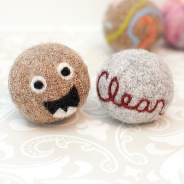 Needle felted designs on laundry balls