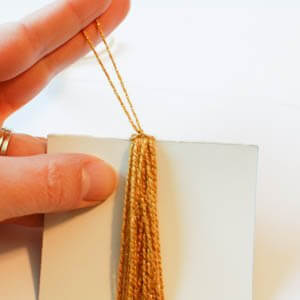 Secure top of tassel
