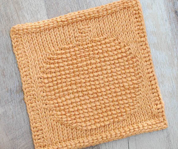 Pumpkin Tunisian Crochet Dishcloth Pattern | www.petalstopicots.com