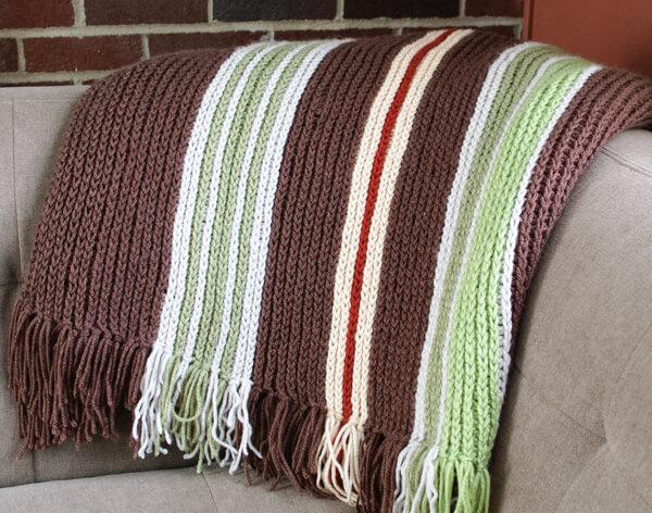 Vertical Striped Crochet Afghan Pattern | www.petalstopicots.com