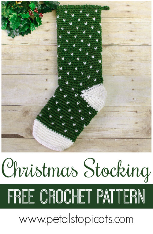 Crochet up this Evergreen Christmas Stocking crochet pattern to adorn your mantel! All you need is two balls of yarn and a weekend and you will have a holiday keepsake that is sure to be enjoyed for years to come! #petalstopicots