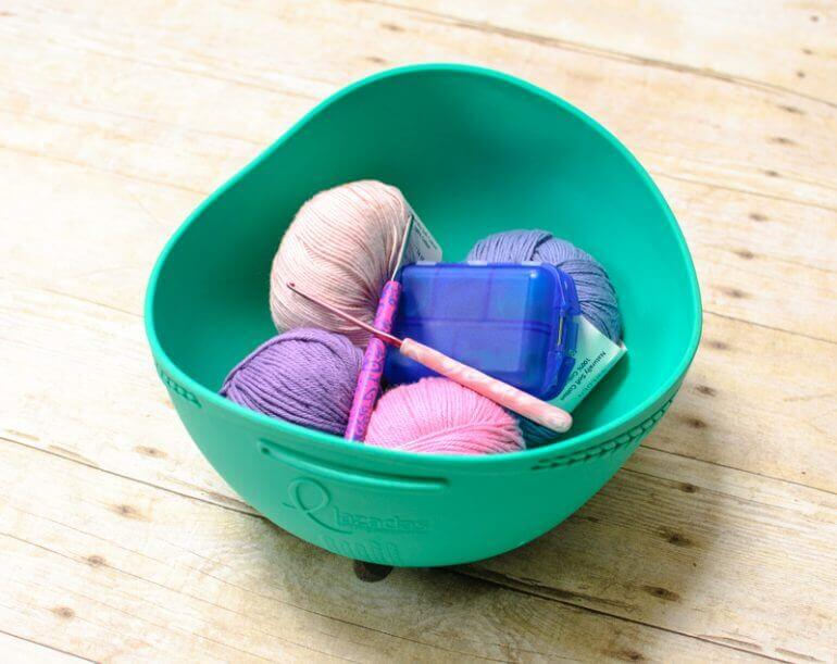 The Lazadas Project Caddy is really very ingenious, transitioning from a carry along bag to a yarn bowl! I\'ve found myself using this little caddy quite a bit. It\'s perfect for smaller projects like socks, lightweight shawls, granny squares, etc. #petalstopicots