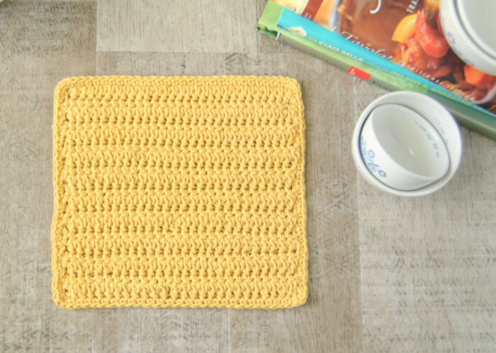 This forked cluster stitch crochet dishcloth pattern creates a beautifully textured and reversible design.