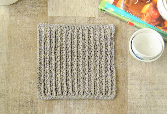 The Cabled Columns dishcloth features deeply textured accent columns produced by alternating crochet post stitches with regular stitches.