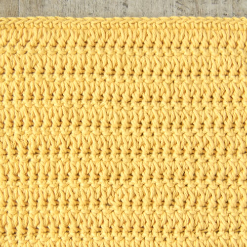 Rows of forked cluster stitches alternated with single crochet stitches worked in the back look only.