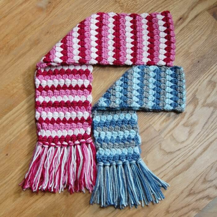Child and toddler size Mod Scarf patterns worked in three colors.