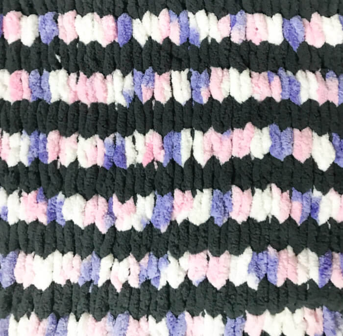 This loop yarn blanket pattern uses two colors in alternating rows.