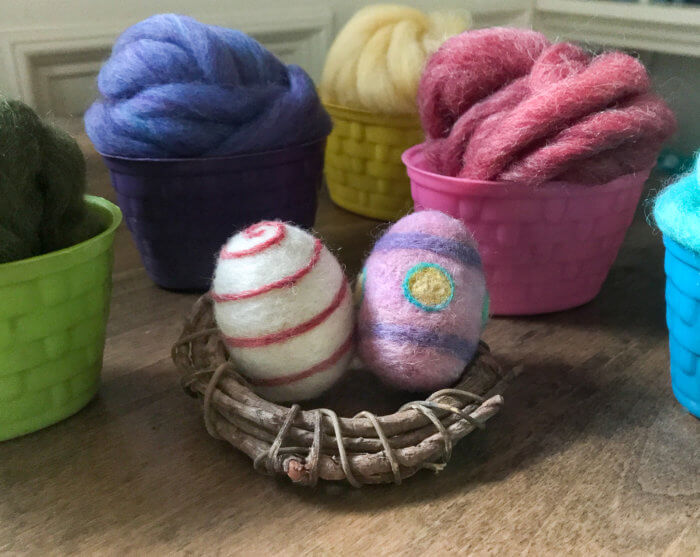 Coloring eggs has never been so fun! Use bits of colorful wool to make lovely felted Easter eggs you can enjoy in your decor for years to come.